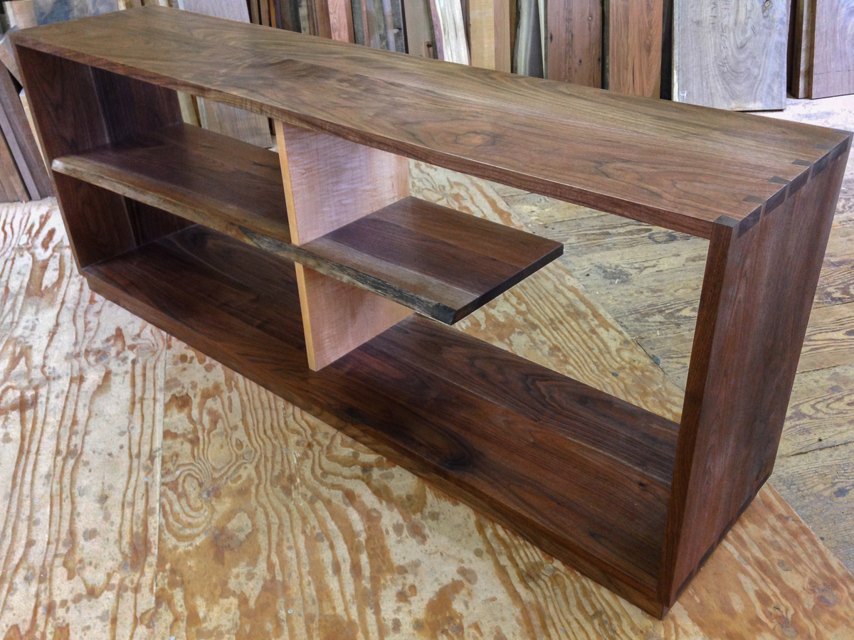 Dovetail walnut case with a live edge shelf and curly maple divider.