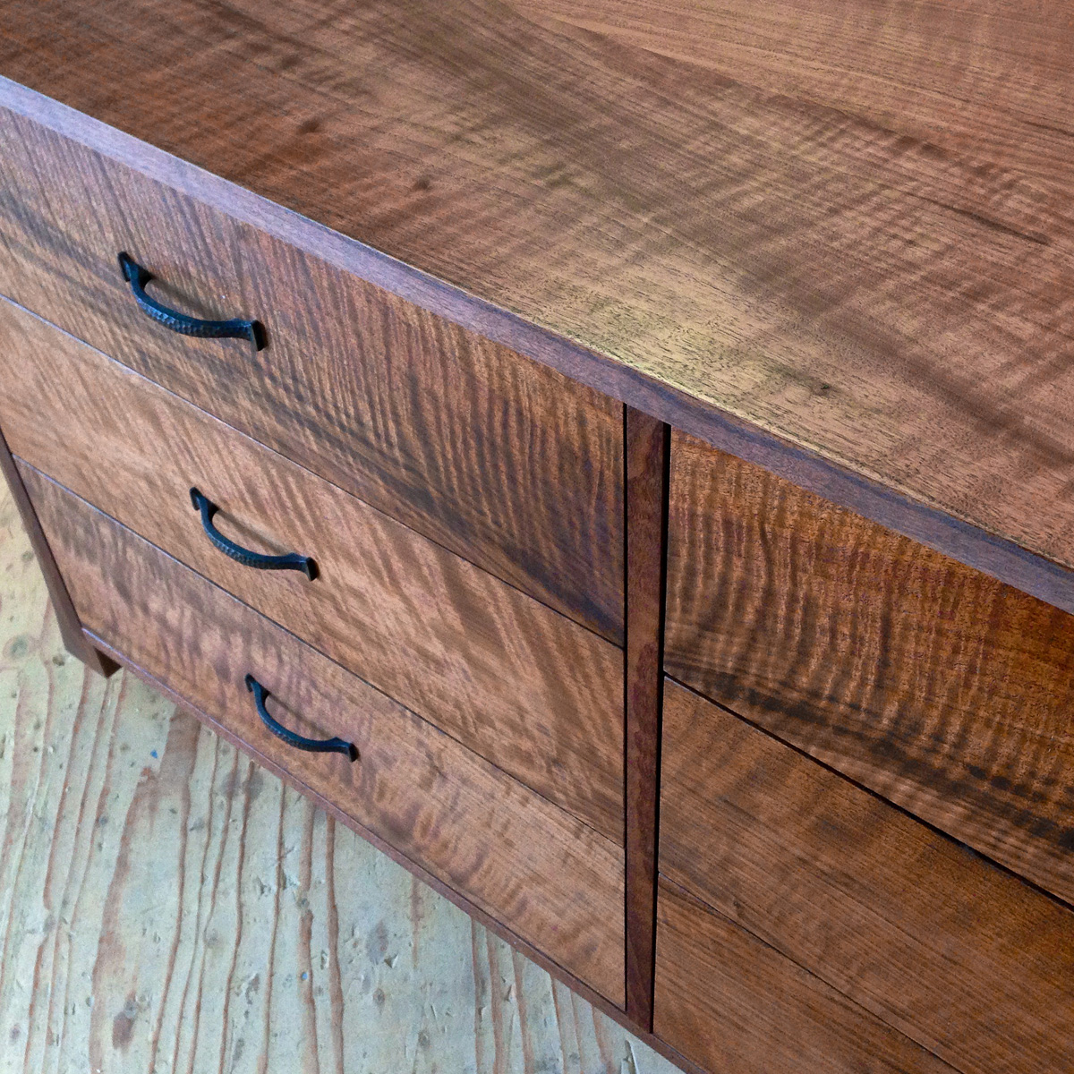 Claro walnut dresser with book matched drawer fronts.