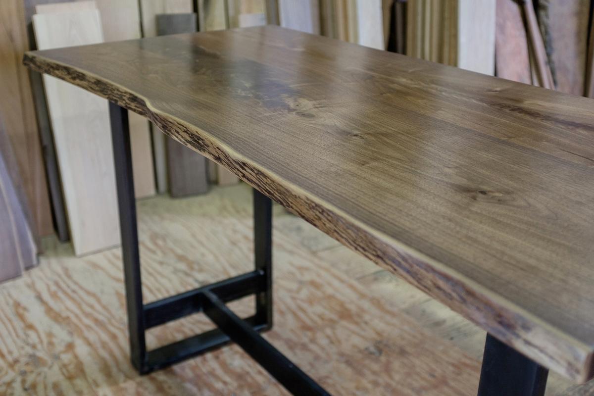 Live edge walnut bar table with steel base.