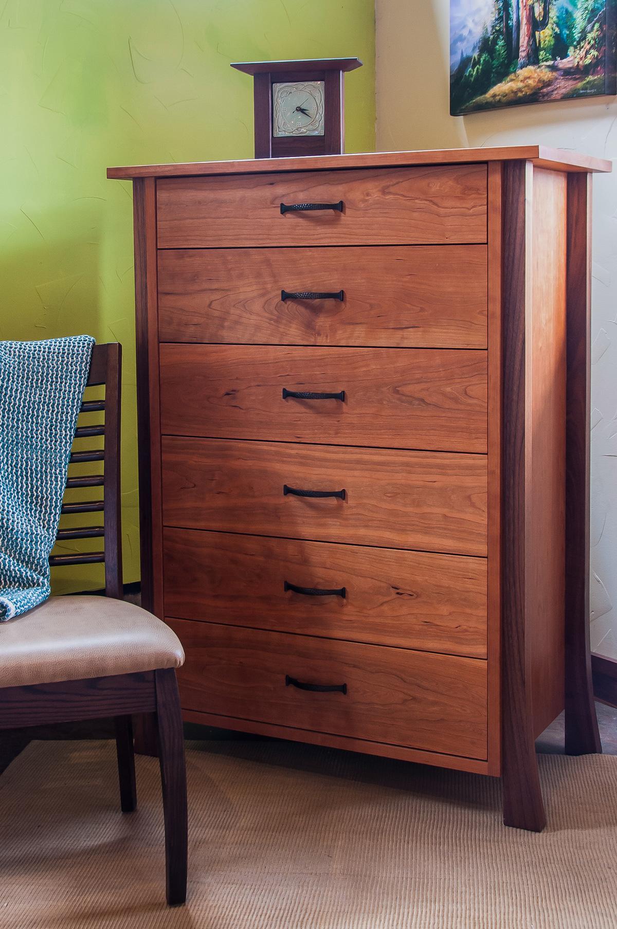 Cherry six drawer dresser with walnut legs.