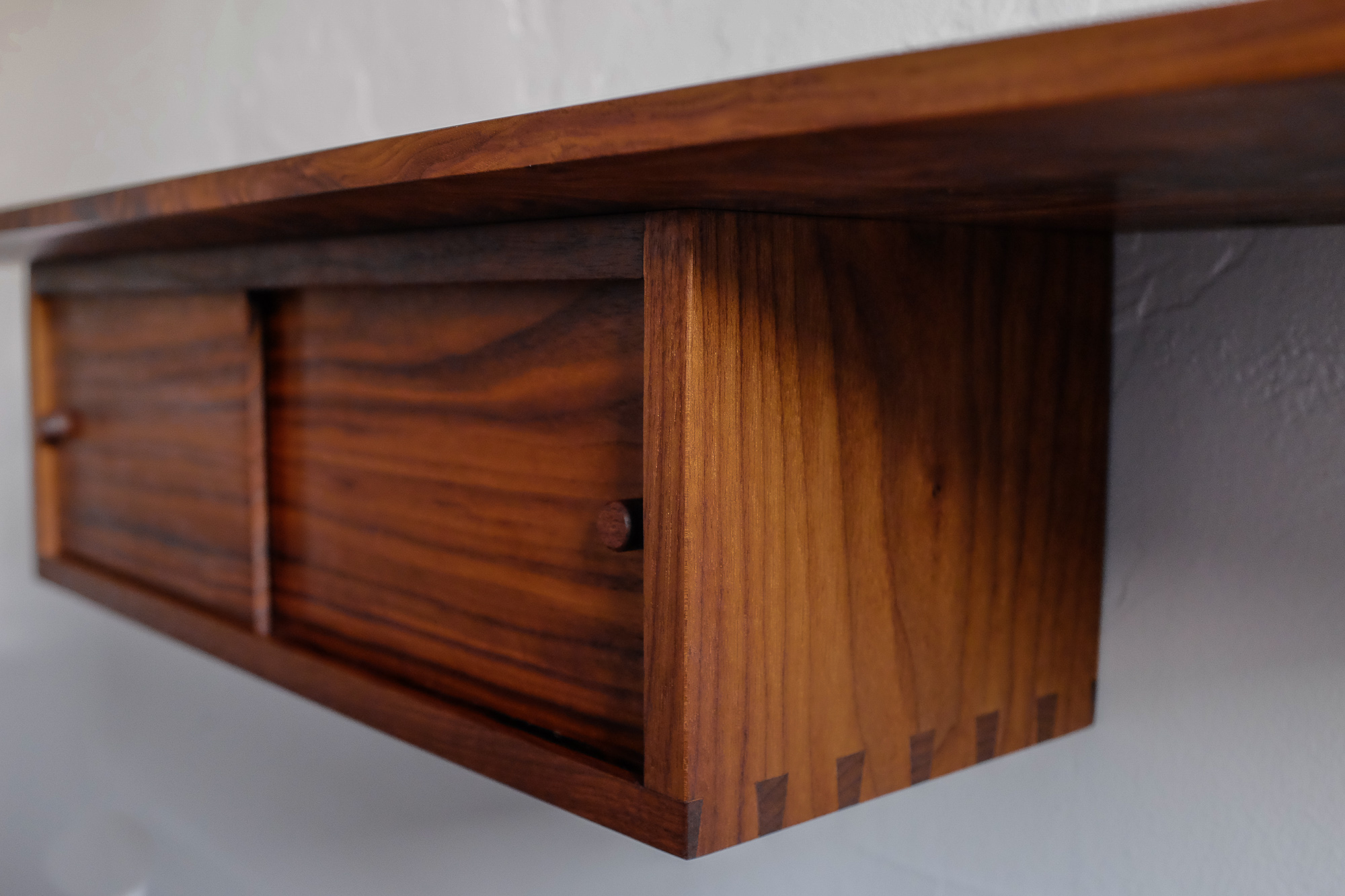 Detail of dovetail and recessed sliding door.