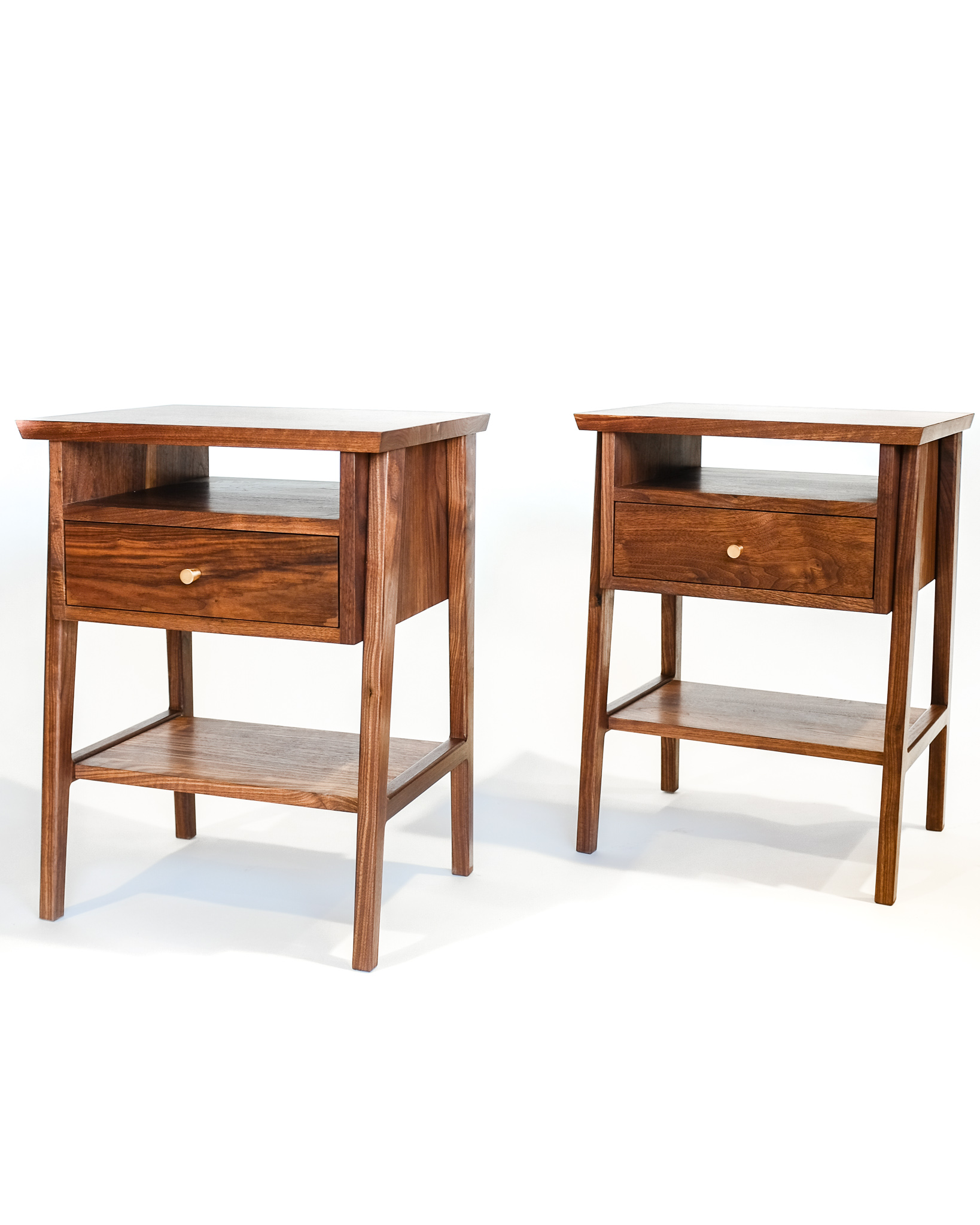 Walnut one drawer nightstands with brass pulls. Also available in white oak or maple.