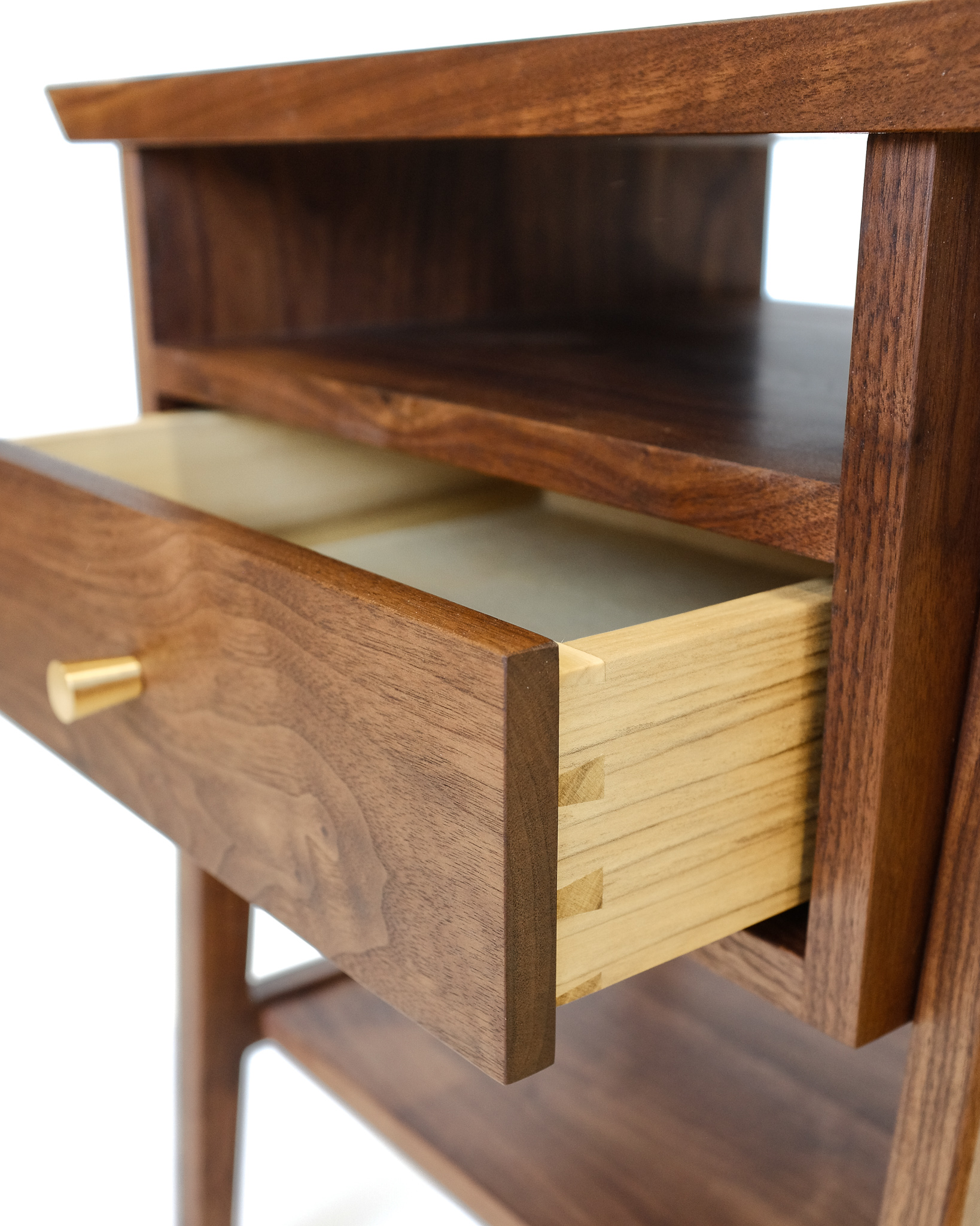 Detail of poplar dovetail drawer in the walnut nightstands. The upper cubby is perfect for book storage while the lower shelf allows additional storage or display.