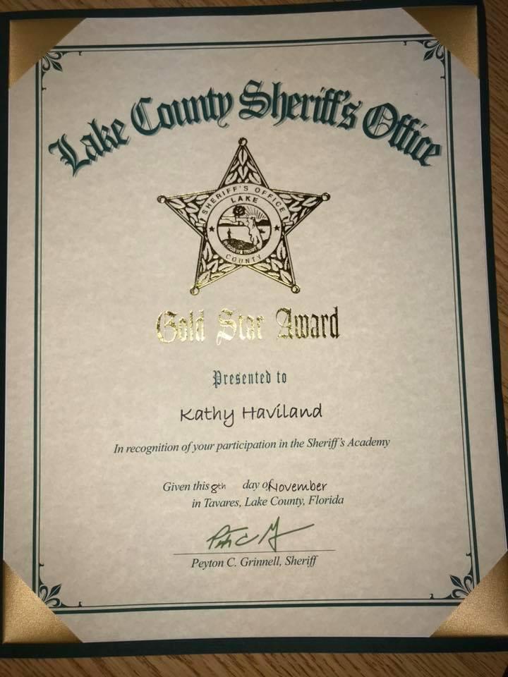 Kathy Haviland at Sheriffs Lake County Citizens Academy Gold Star Award.jpg