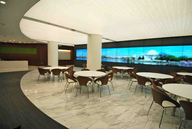 The gathering area also acts as overflow for the seminar room. Content can be sent to the video wall and audio plays from in-ceiling speaker systems.