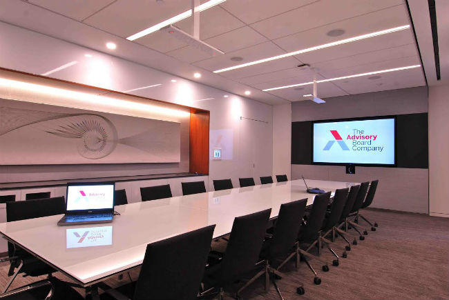 The larger of two stand-alone conference rooms is equipped with a 90-inch Sharp display