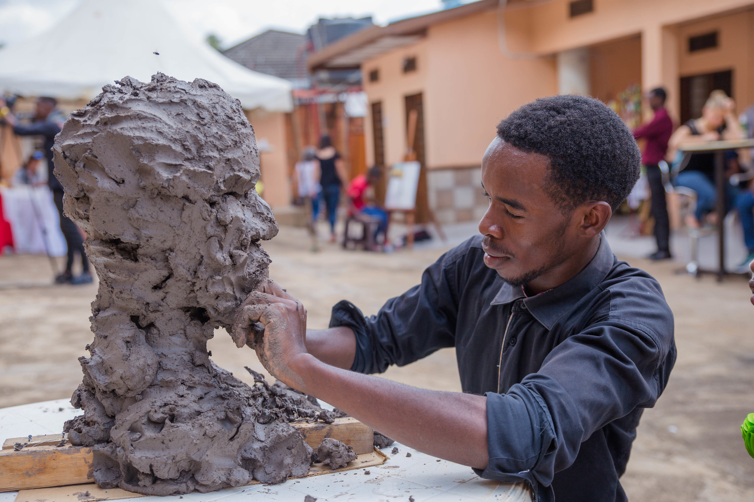 Remy performs a live sculpture at an event at Envision Rwanda