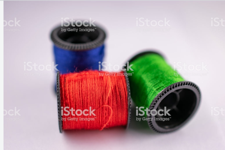 Thread Bobbins on White.