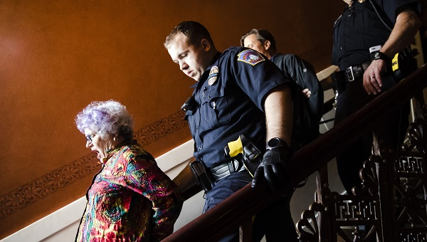 Carol Stowell, MoH York Chapter Leader, being arrested after interrupting House Session. Photo credit: AP