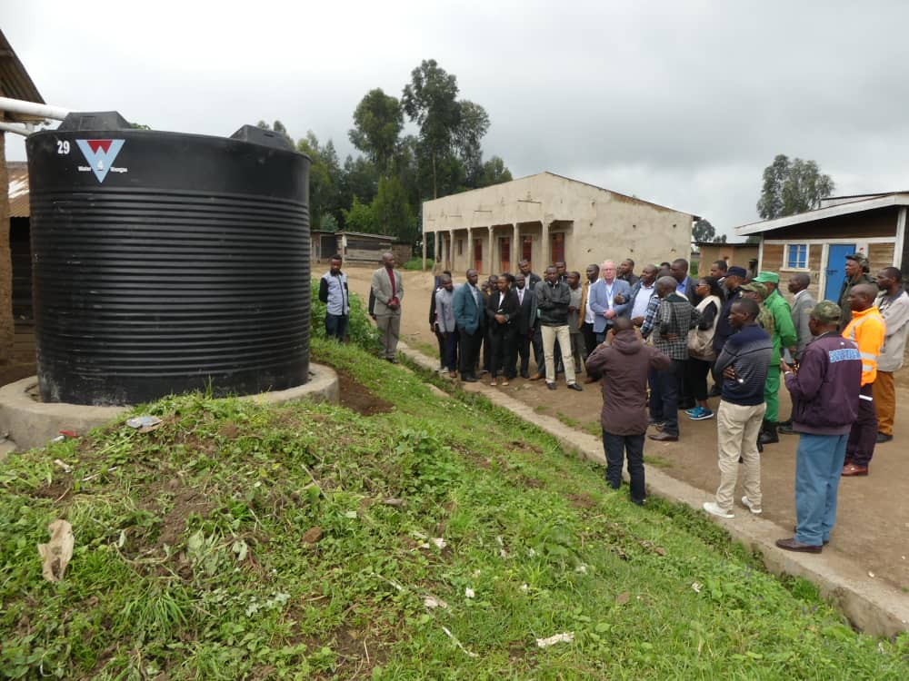 Participants at the launch checking out one of the newly installed rain water harvesting tanks.