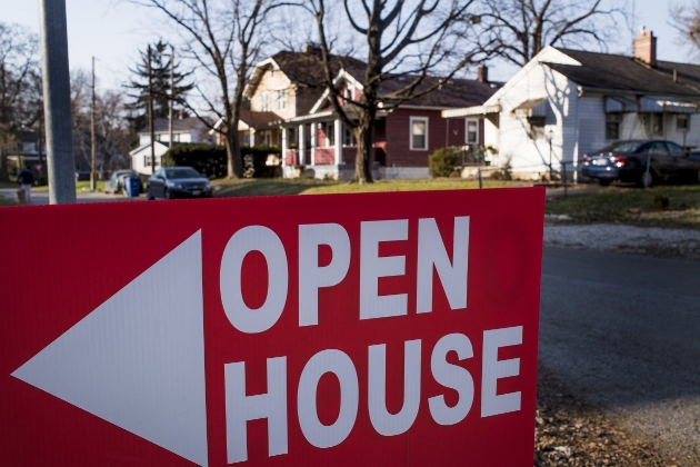 An 'Open House' sign in Columbus, Ohio, late last year. Mortgage rates have risen higher than many economists predicted.PHOTO:TY WRIGHT/BLOOMBERG NEWS