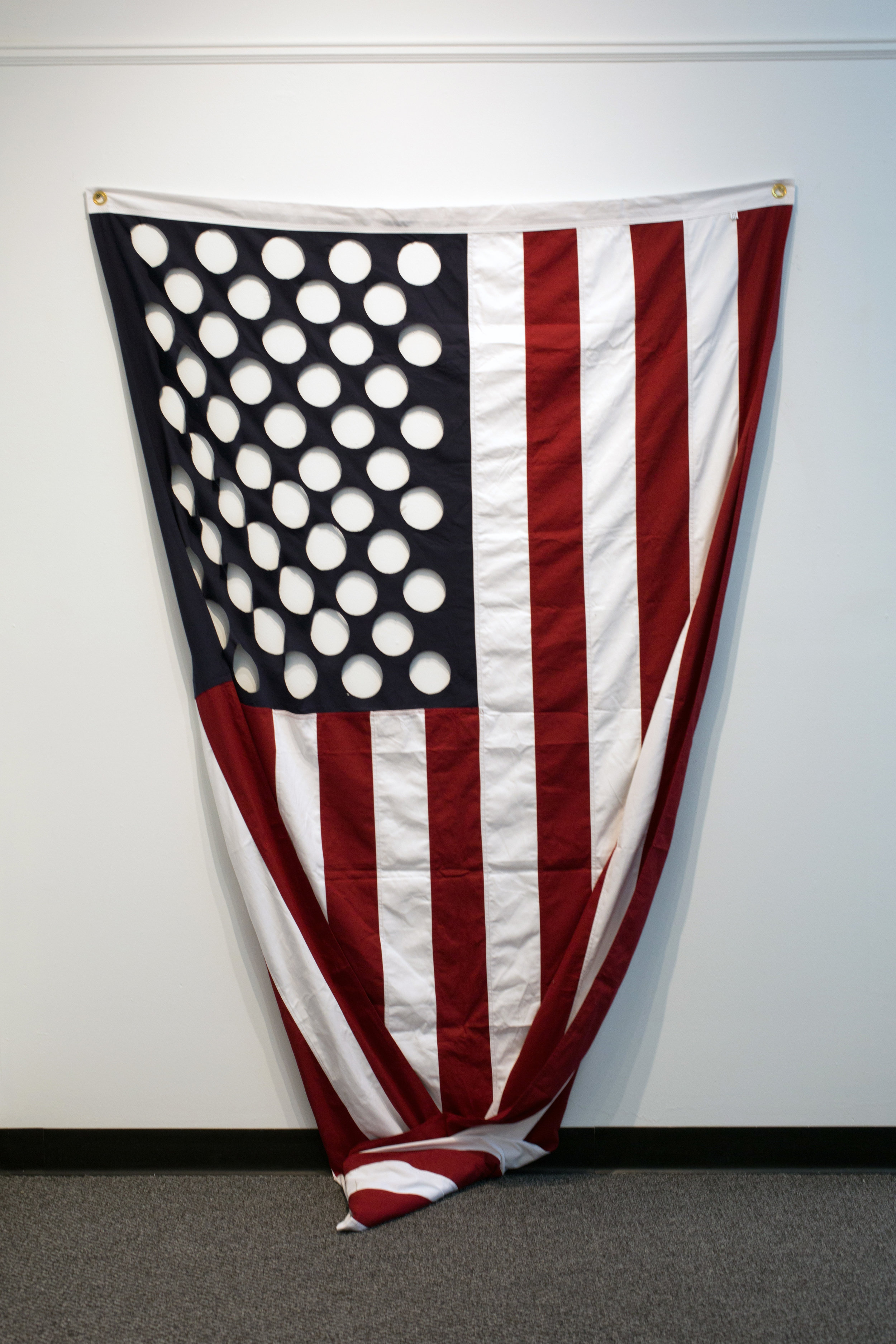 """#27 (War is Peace…)  United States Burial flag on glass 48""""x36""""x6"""" 2018  Photo Courtesy: Anna C. Robertson"""