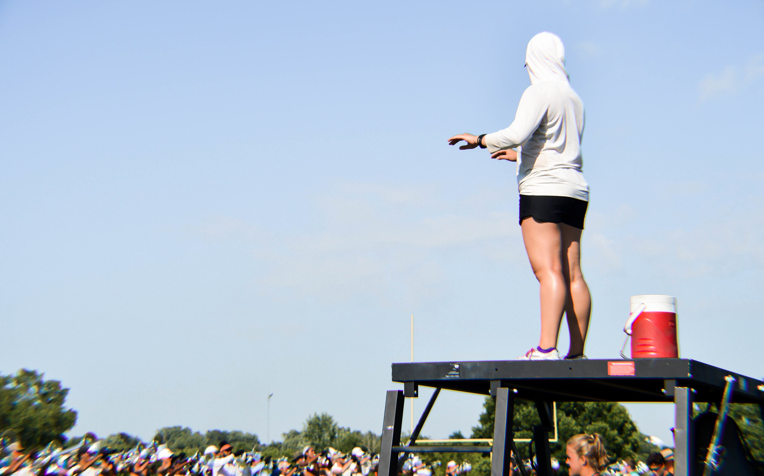 Drum Major, Kristin Hodges conducts during visual rehearsal