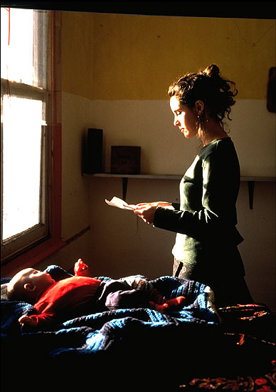 Tom Hunter,  Woman reading a Possession Order,  1997