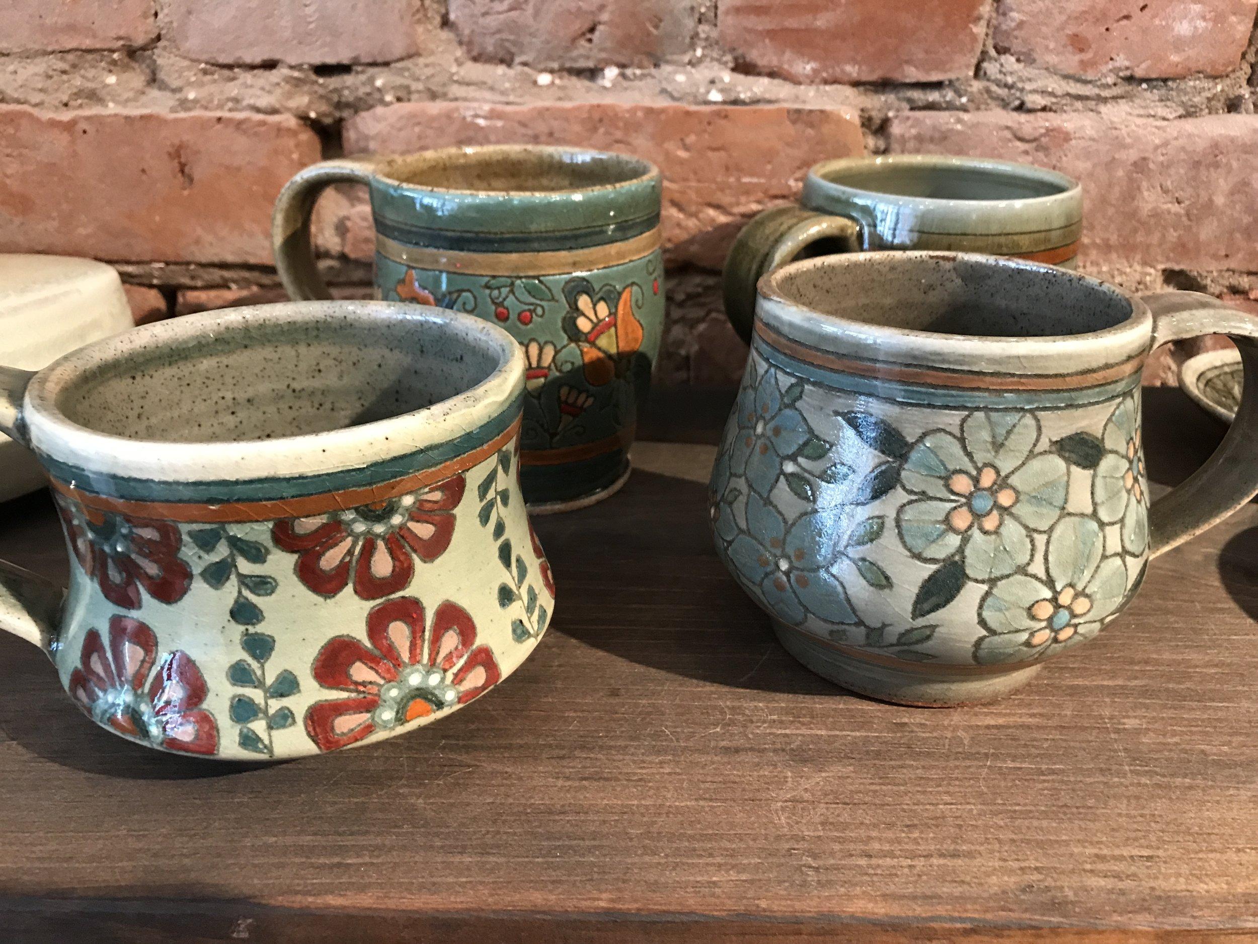 #21 amr mugs on bricks.JPG