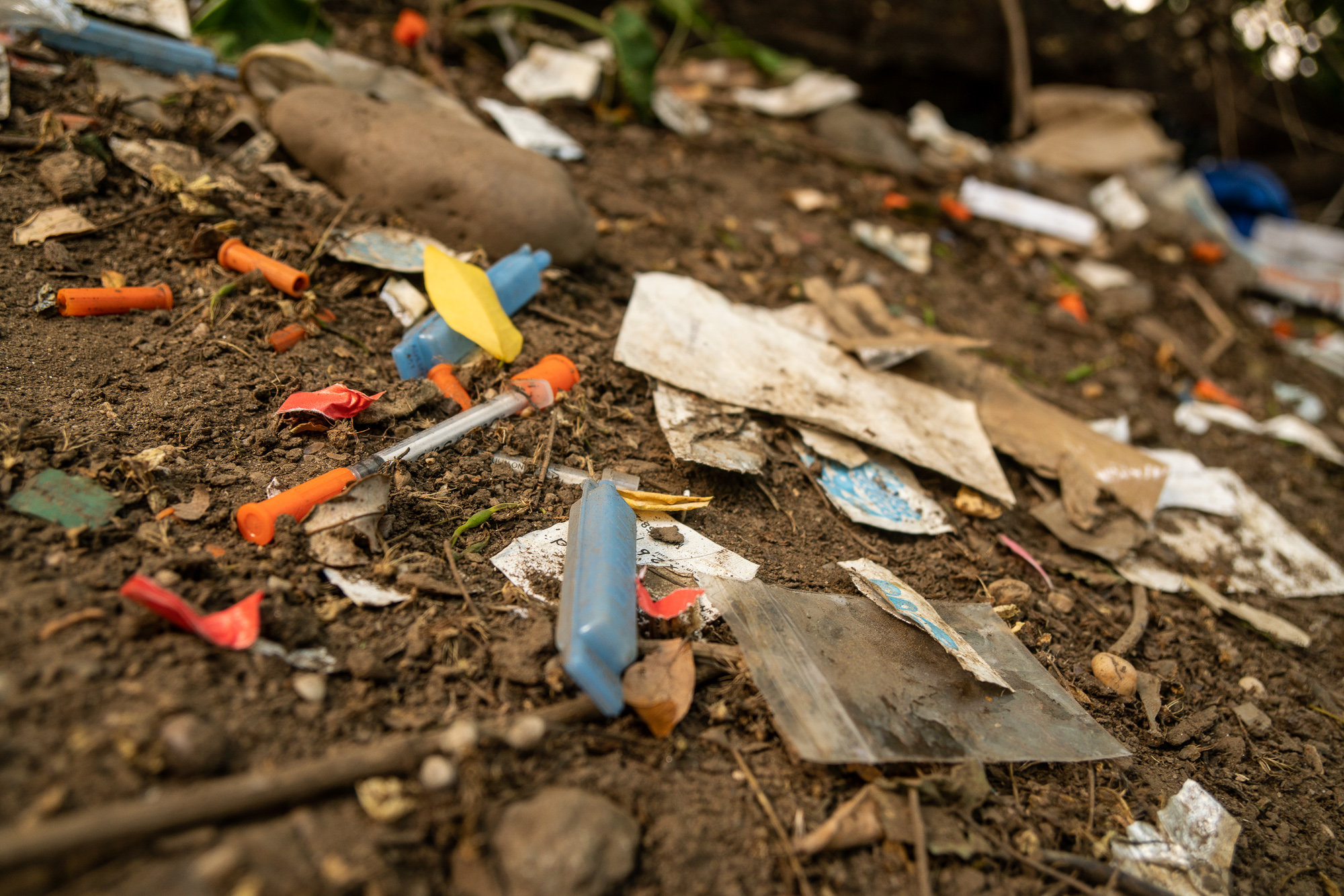 Old syringes; needle caps; water containers. Only some of all the drug paraphernalia on the ground in Highbridge Park.