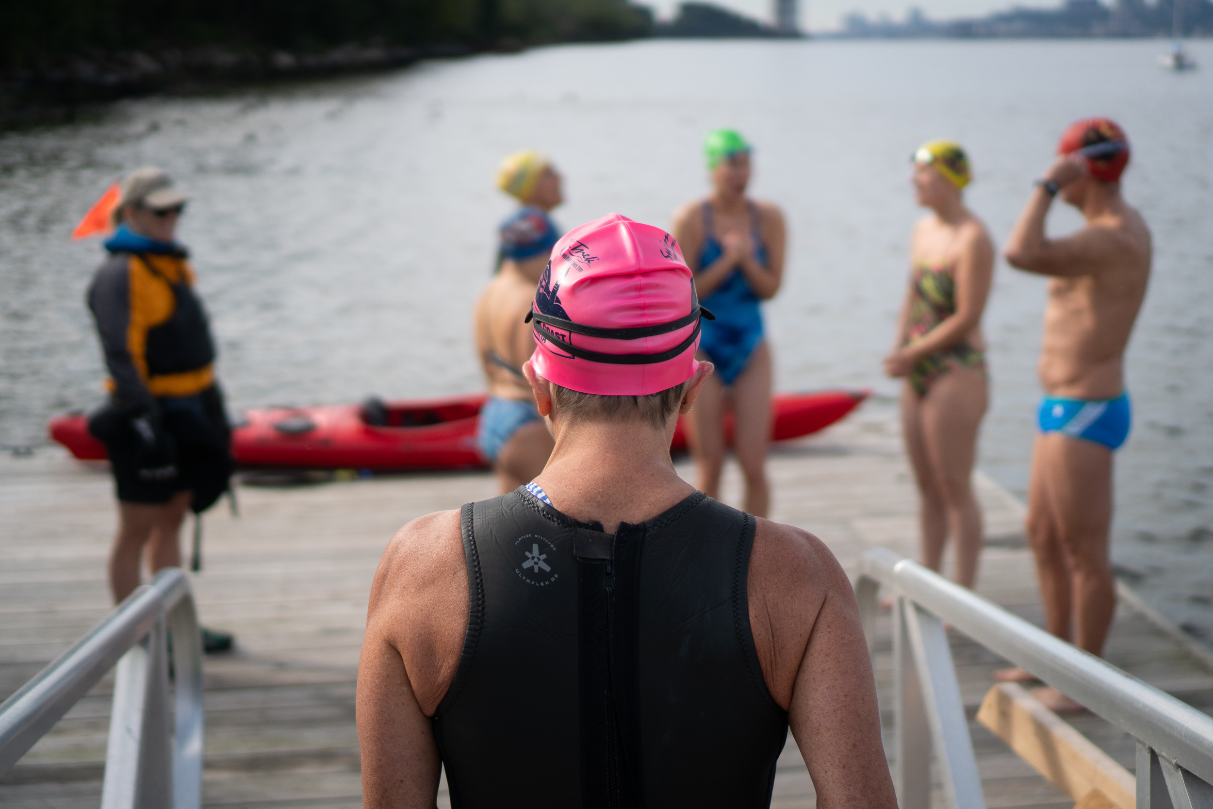 A swimmer heading down the pier at Inwood Canoe Club.
