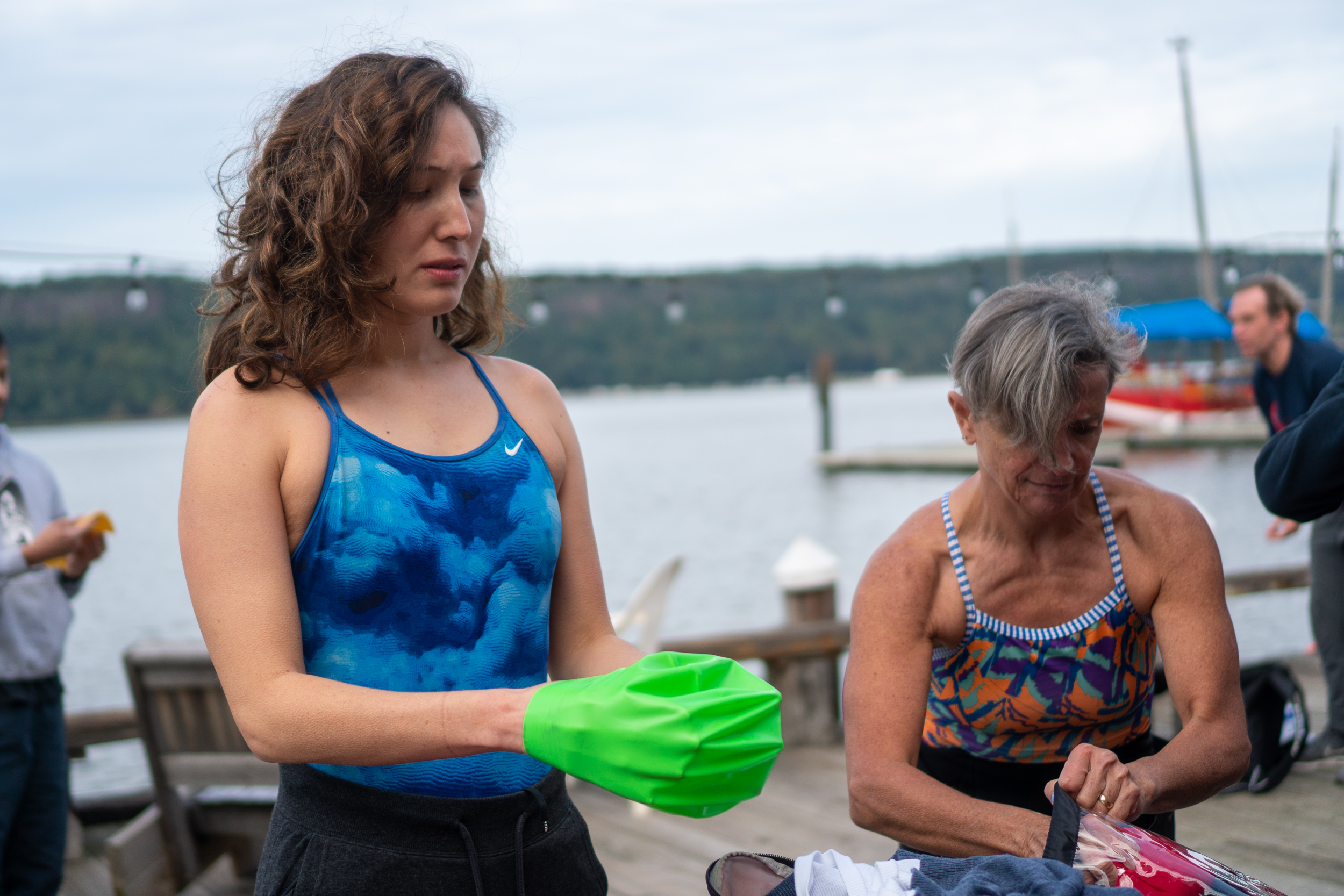 Jennifer Snyder puts on her swim cap before the Hudson swim. She is an experienced open water swimmer and swam around Manhattan in 2017.