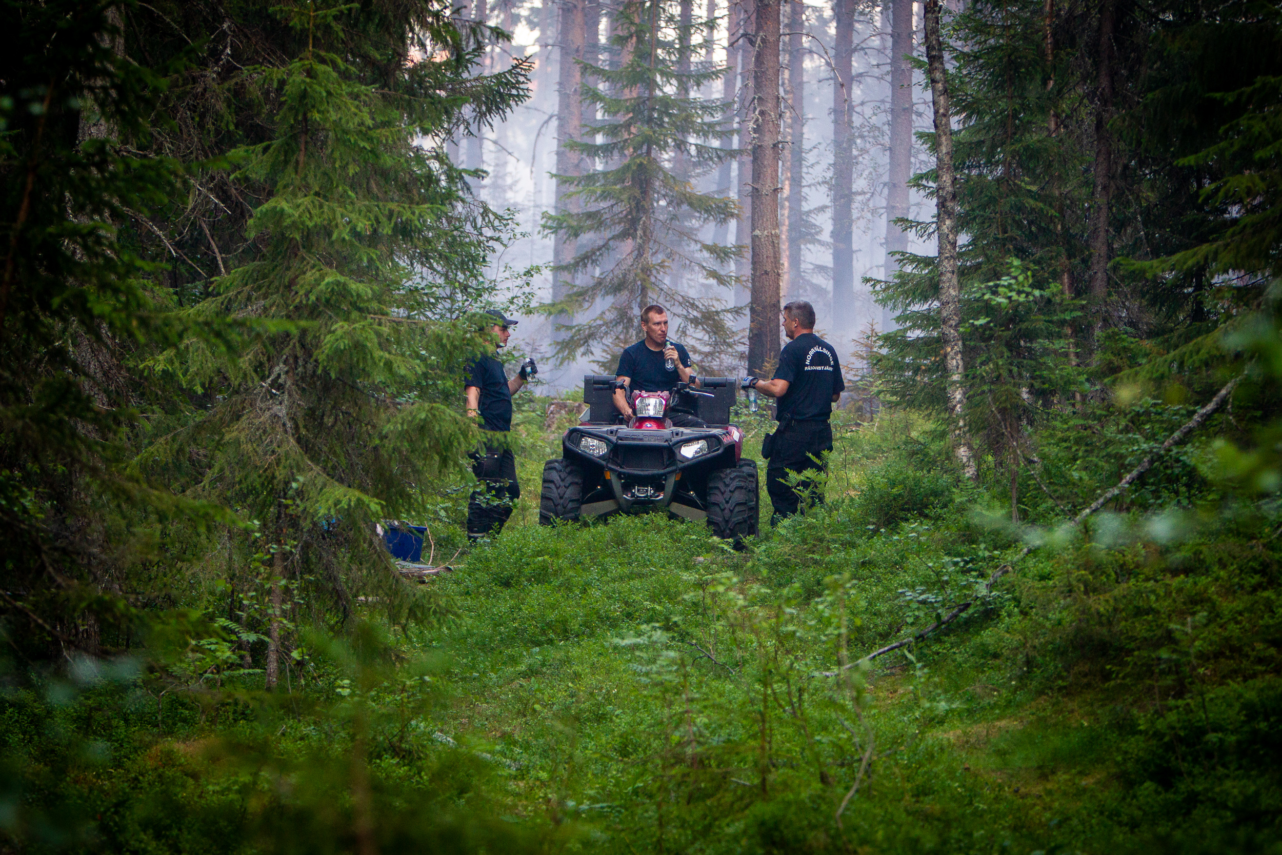 ATVs make it easy for firefighters to move between new places where the fire might flare up.