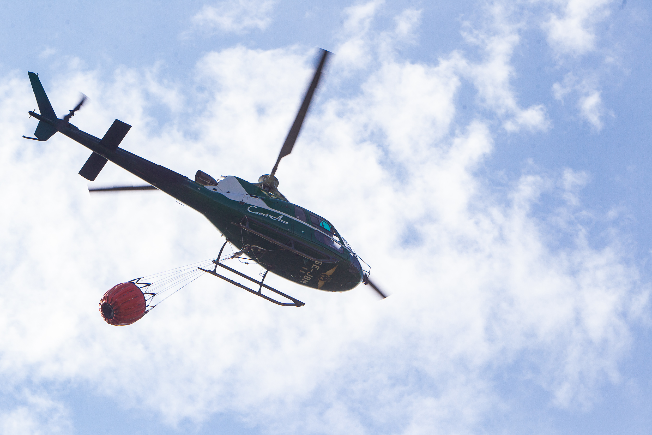 Helicopters are used to more effectively put out forest fires, carrying more than a 700 litres on water each turn.
