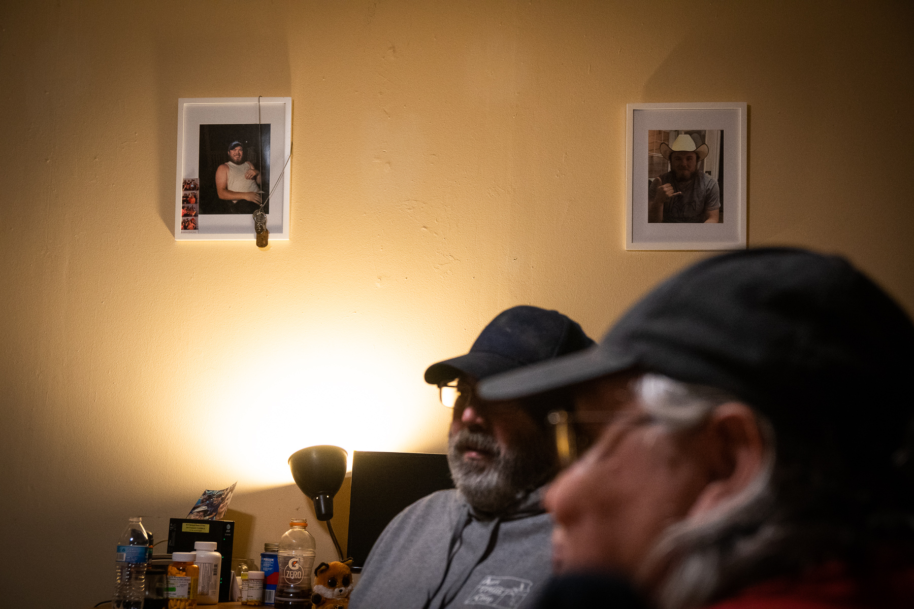 Photos of Casey Schardein, who died in a car accident on August 18, 2018, hang in the living room of his parents, Ed and Iwonne Schardein of Herington, Kansas, on January 15, 2019.