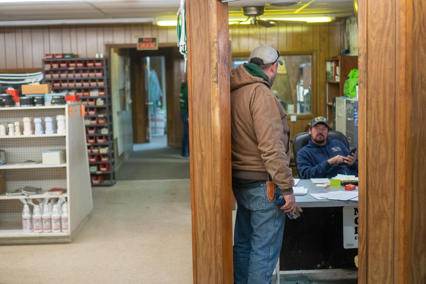 Gene Kickhaefer, branch manager at the Agri Trails Co-op in Navarre, Kansas, talking to Jordan Gott in his office on January 16, 2019. He explained it his hard to find dedicated workers like Casey Schardein that are willing to stay on.
