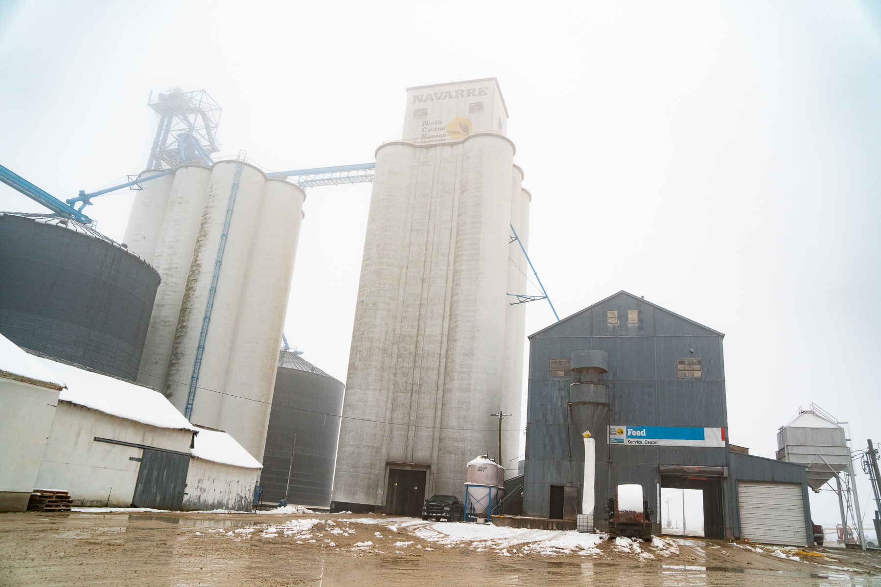 The grain elevator in Navarre, part of Agri Trails Cooperative, where Casey Shardein worked in the grain mill (right), in January 2019.