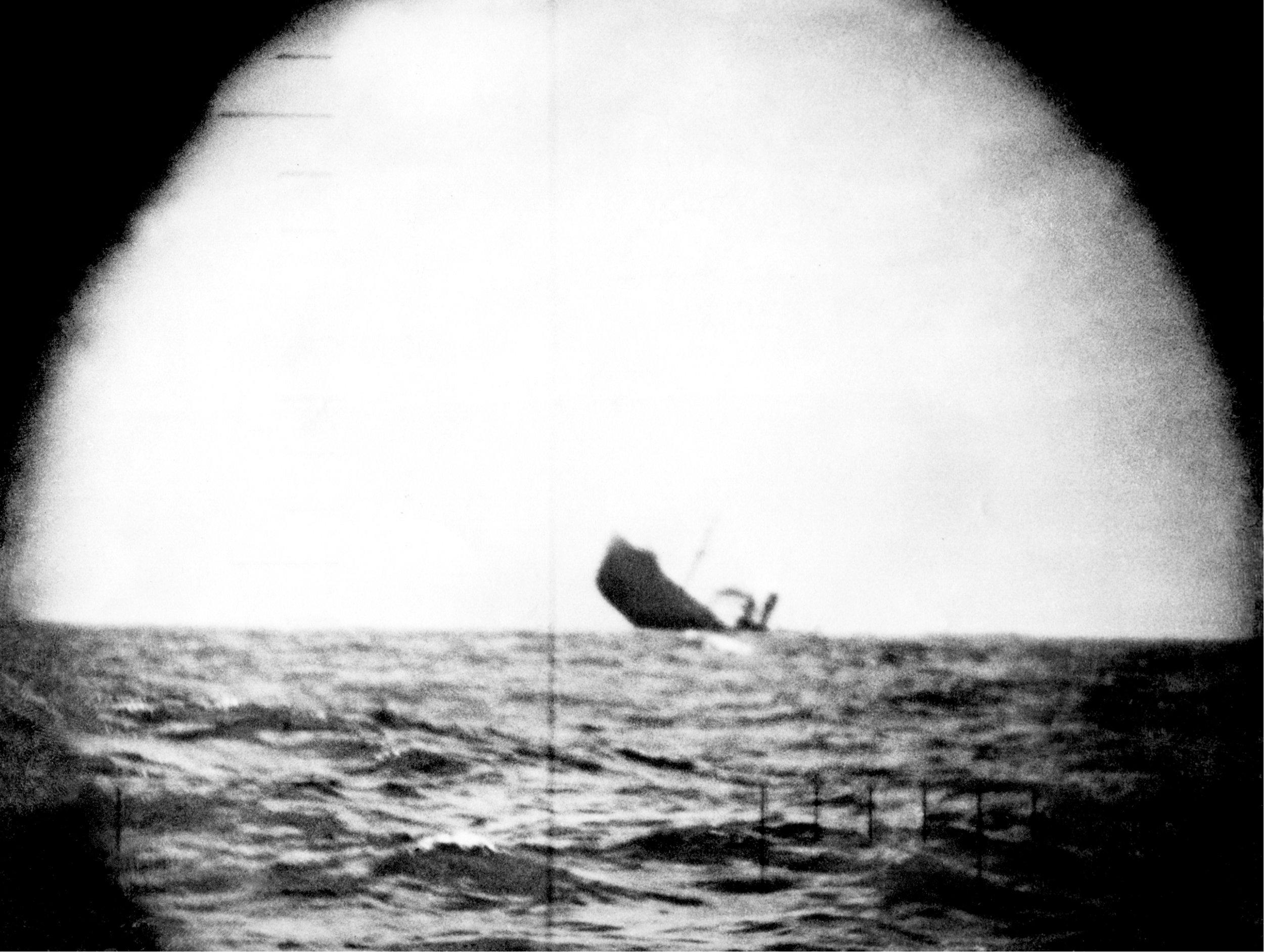 US submarine periscope photo of Japanese cargo ship being torpedoed