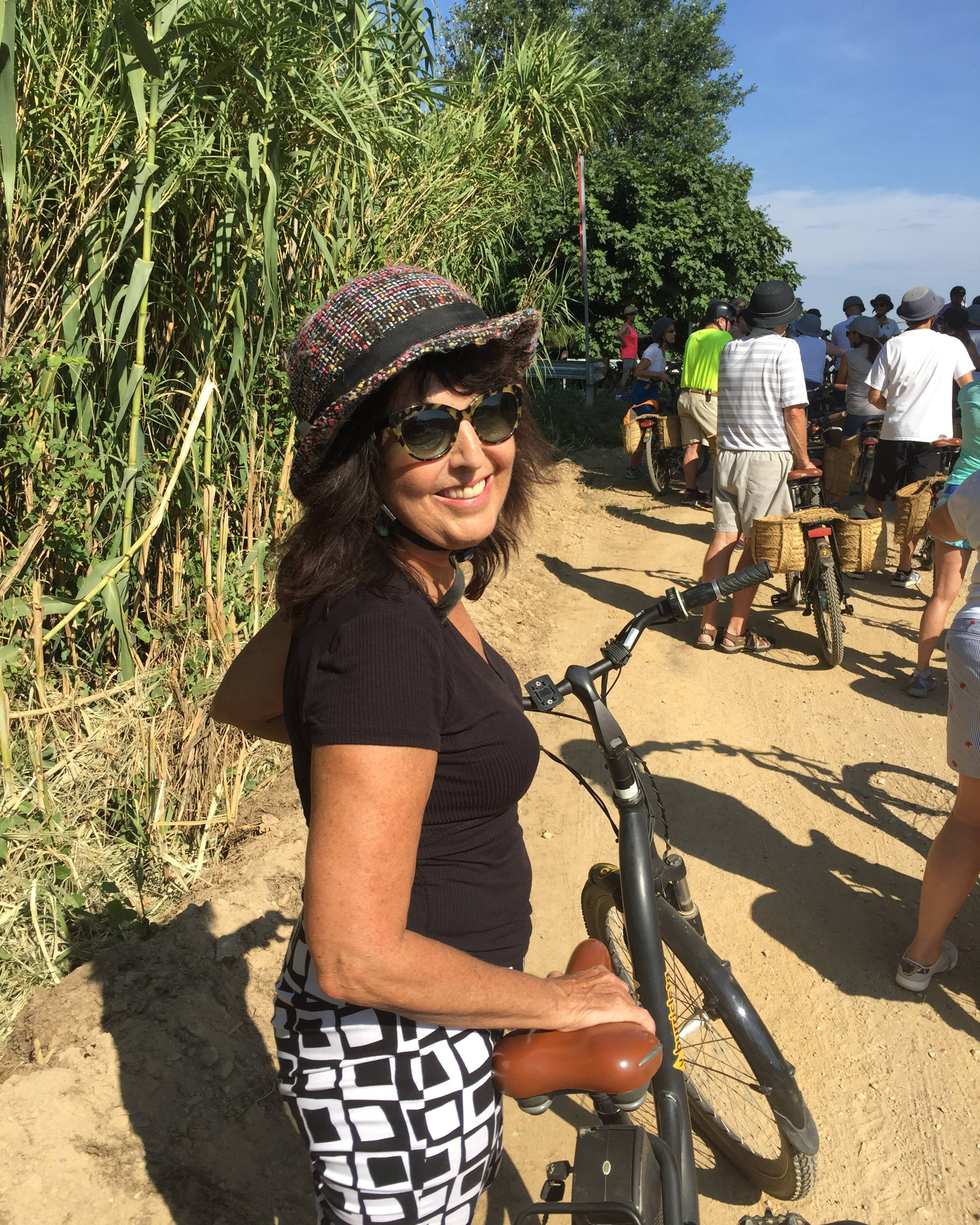 Jeri Donovan, Founder of Well Traveled tickled to be bike riding to Pals, Spain on a fun-filled Seabourn excursion.