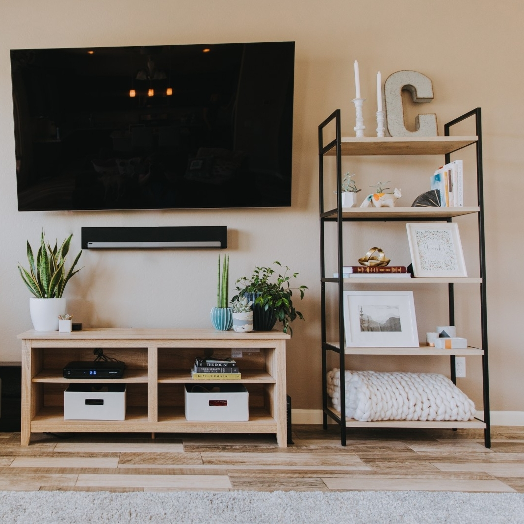 step 4— the big stuff - Target has a large selection of affordable furniture, and our next purchase was this beautiful book shelf and an entertainment center/TV stand. Check this article for details on how to decorate your book shelf.