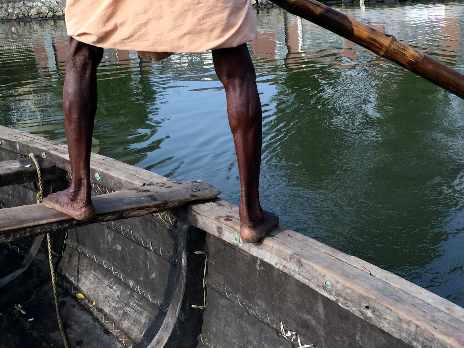 man-rows-boat-south-india.jpg