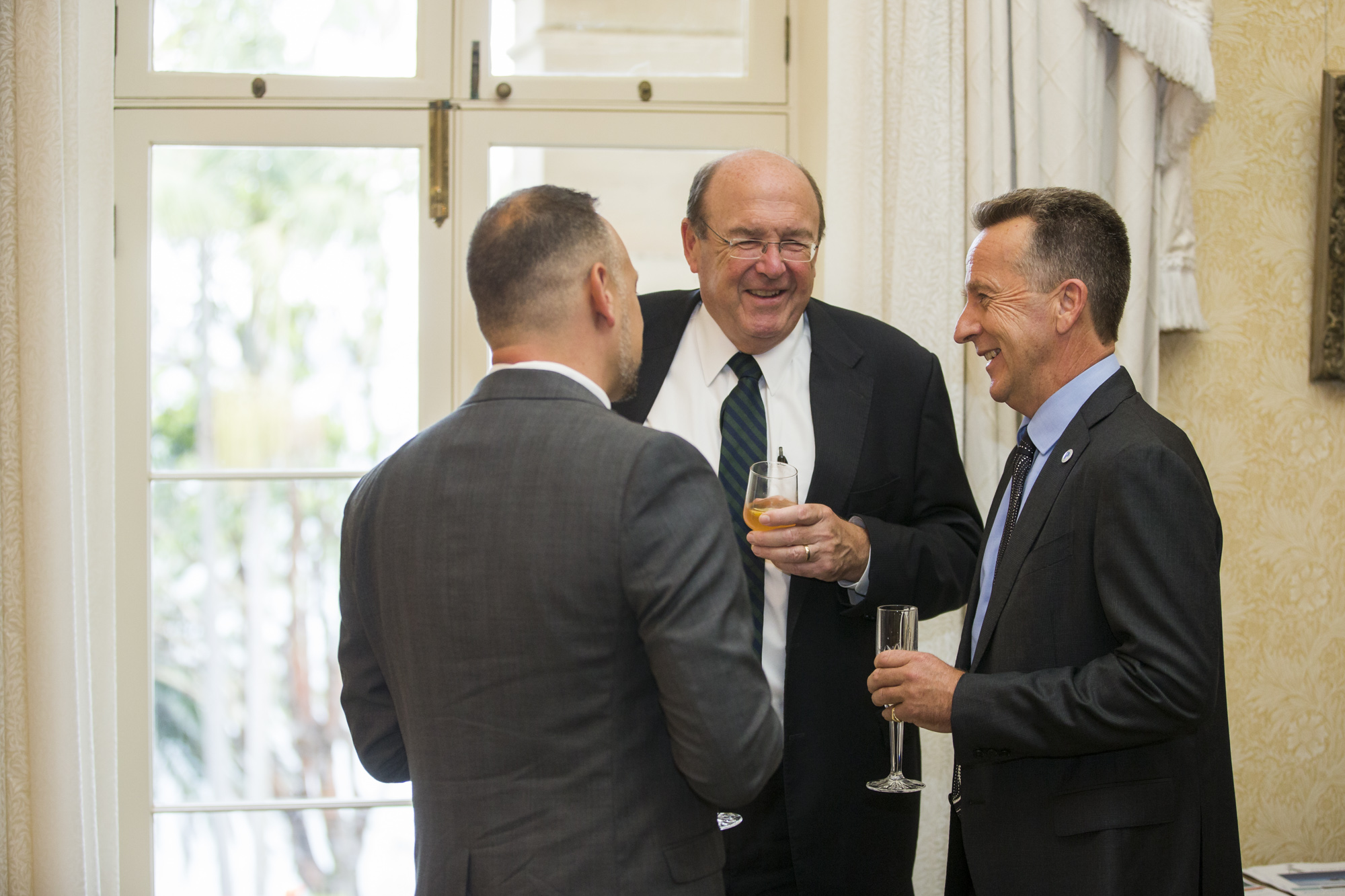 Chair Macquarie Bank, Peter Warne and Australian Antarctic Division Former Director Nick Gales share a joke with Troy Guenther