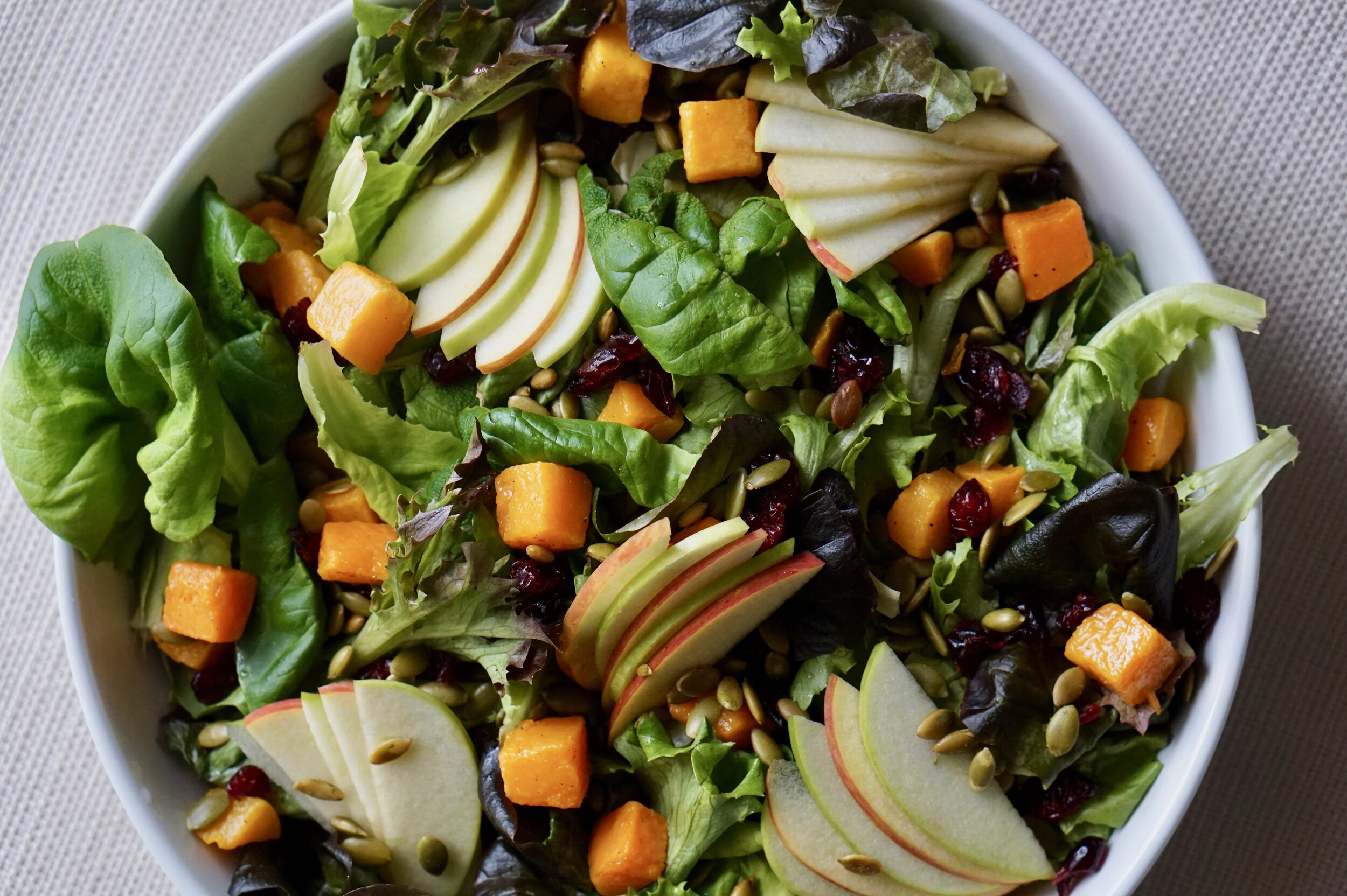 A perfect healthy addition to Thanksgiving dinner, or any fall meal, this salad combines all the best flavors of autumn with fresh, local greens.