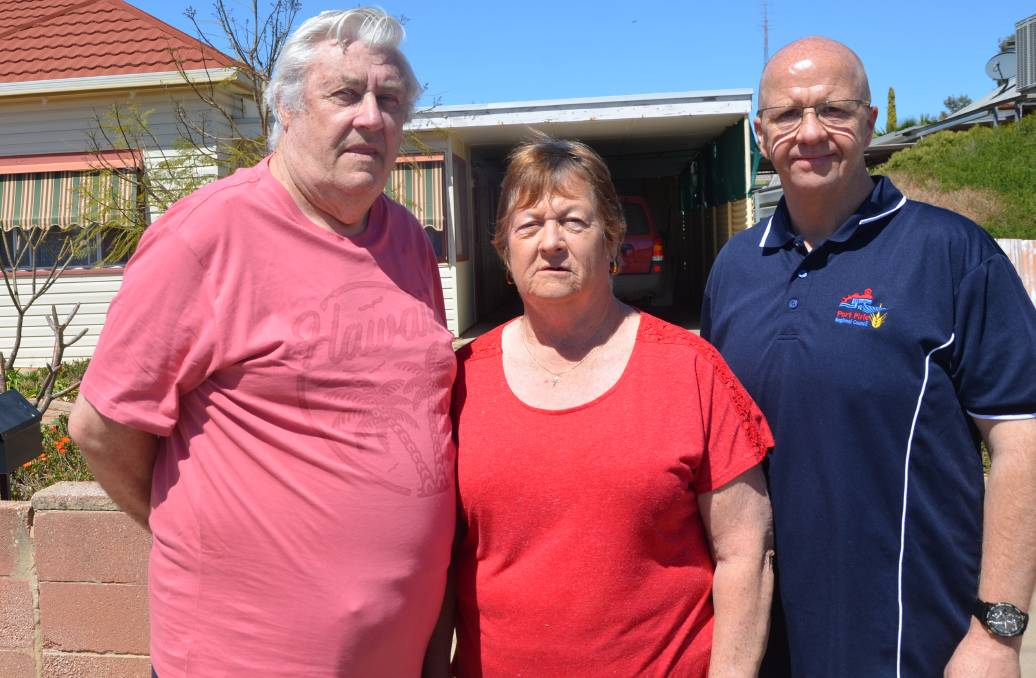 GREAT IDEA: Gordon and Lorraine Williams were excited at the prospect of installing a solar system on their modest home in Esmond Road. They are with council's James Holyman, right.