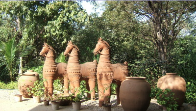Terracotta statues in the gardens of Darpana