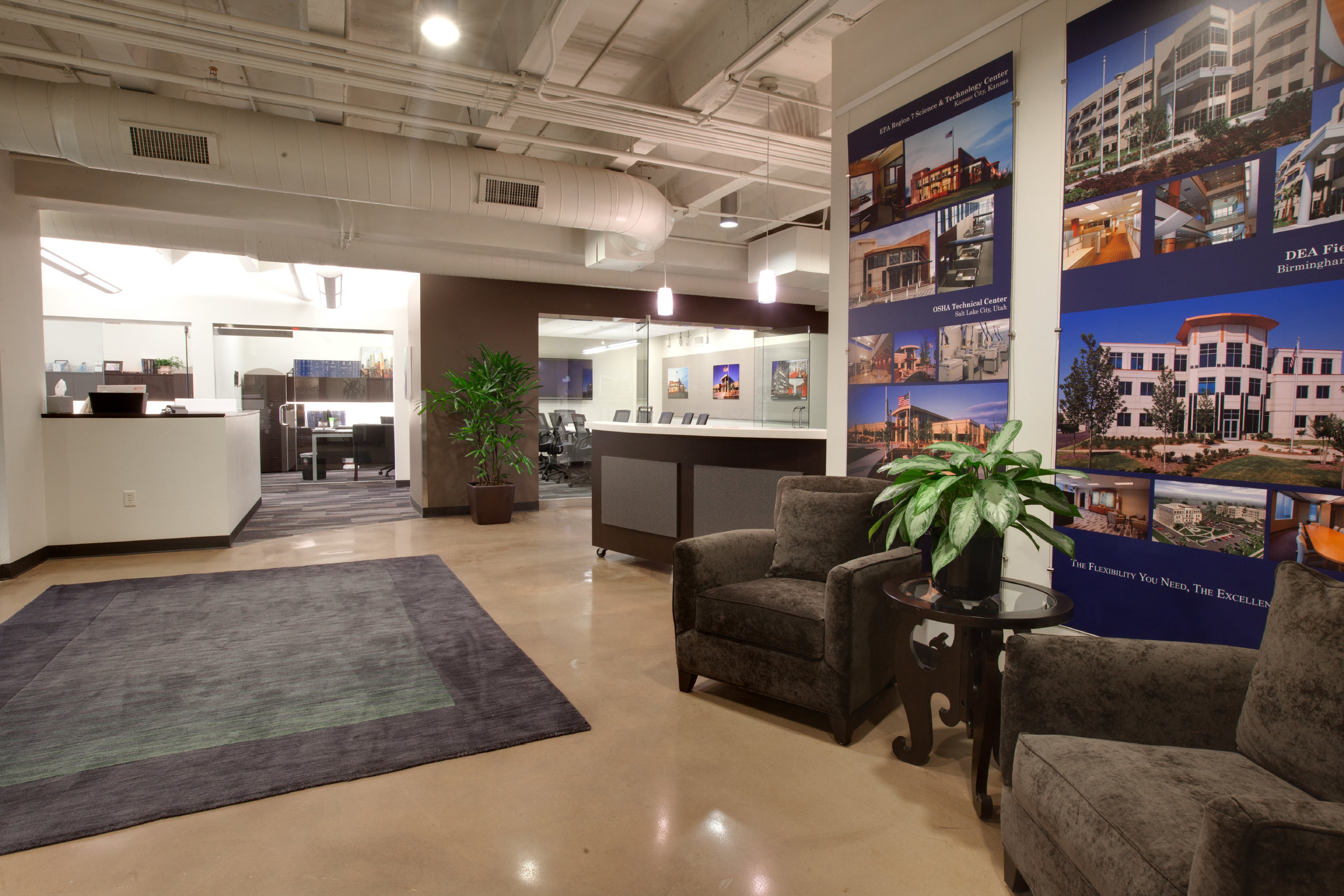 Overstuffed chairs provide a comfortable waiting area in CBC Real Estate's new office