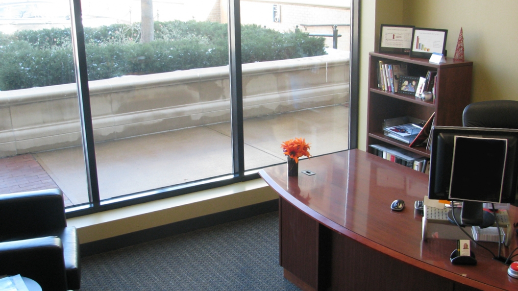 A spacious office includes large windows and natural light in ReeceNichols their newly remodeled Kansas City corporate office space