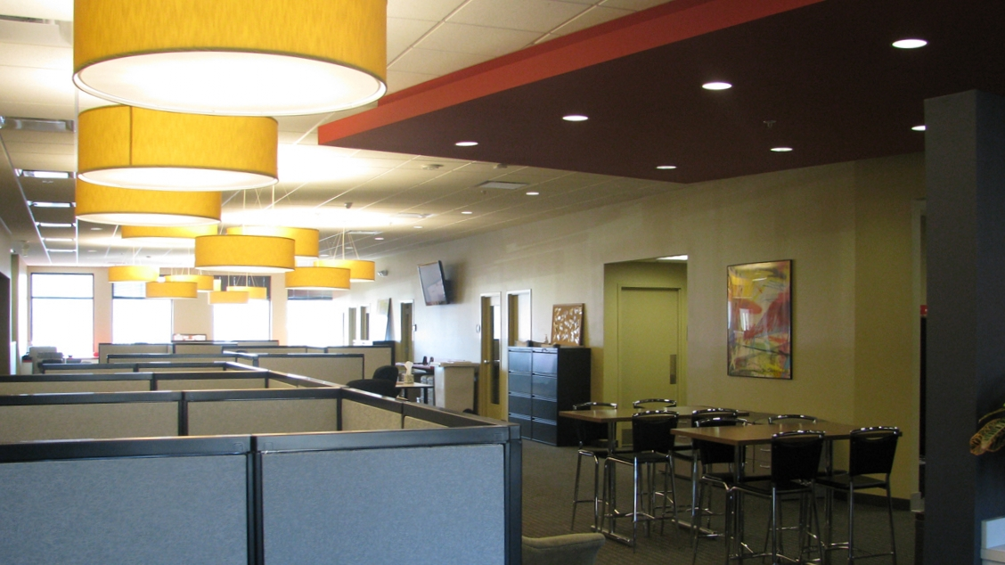 Cubicles and fun light fixtures fill a newly-remodeled ReeceNichols office