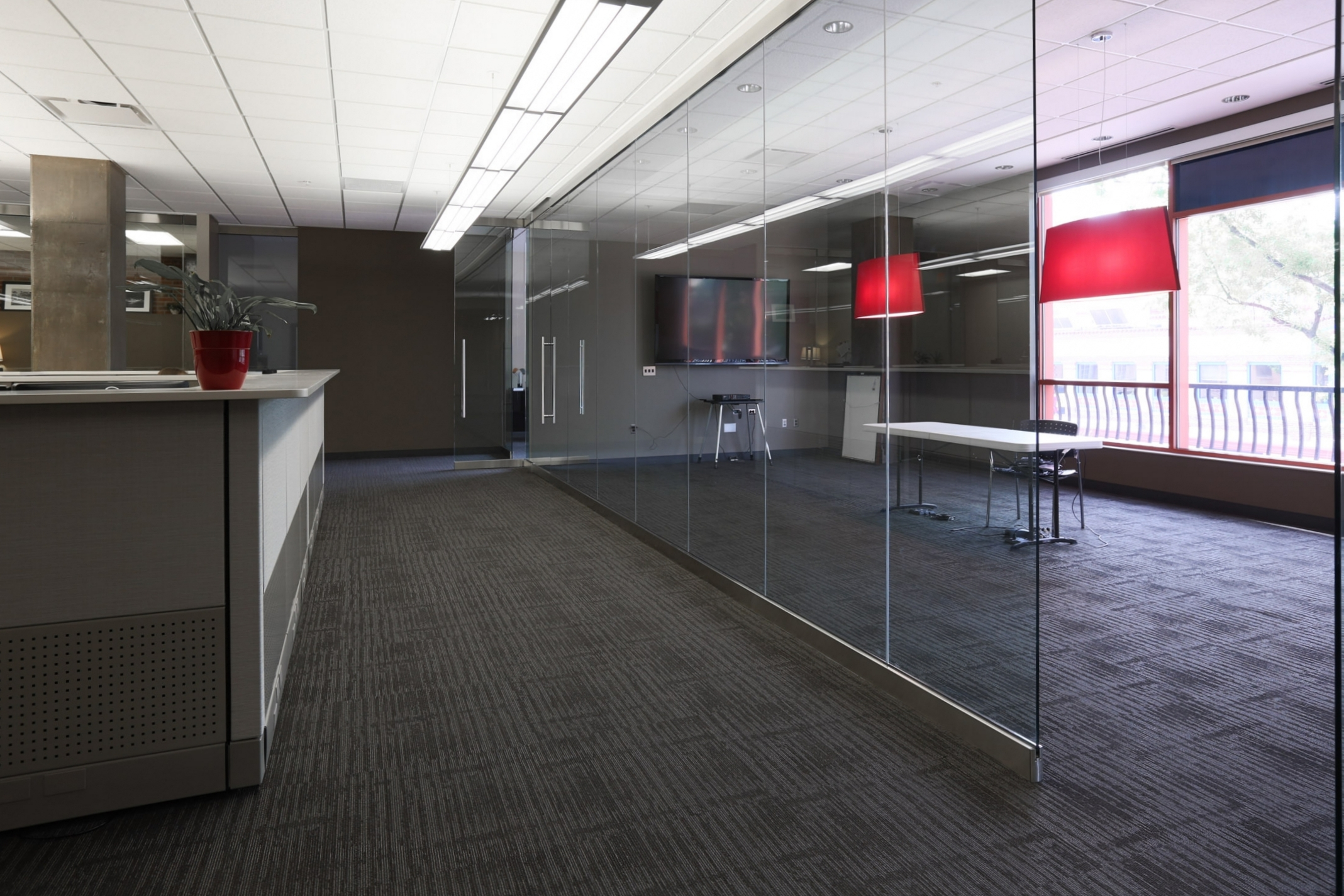 A glass conference room in Stueve Siegel Hanson's newly-remodeled Country Club Plaza office