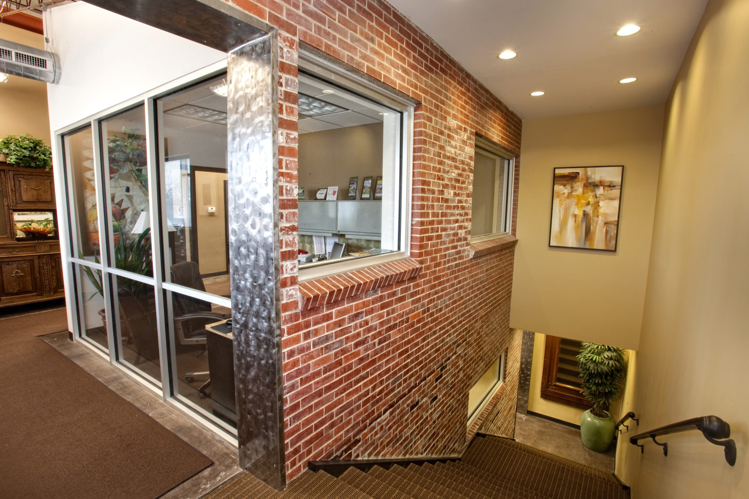Glass-walled office space and stairwell