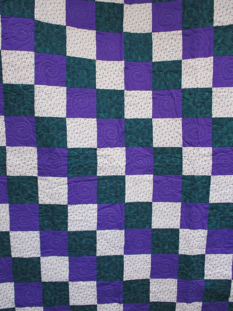 21, PURPLE DREAM (machine quilted), 58x76, Pieced by Mildred Groff, Donated by Cumberland Valley Relief Center
