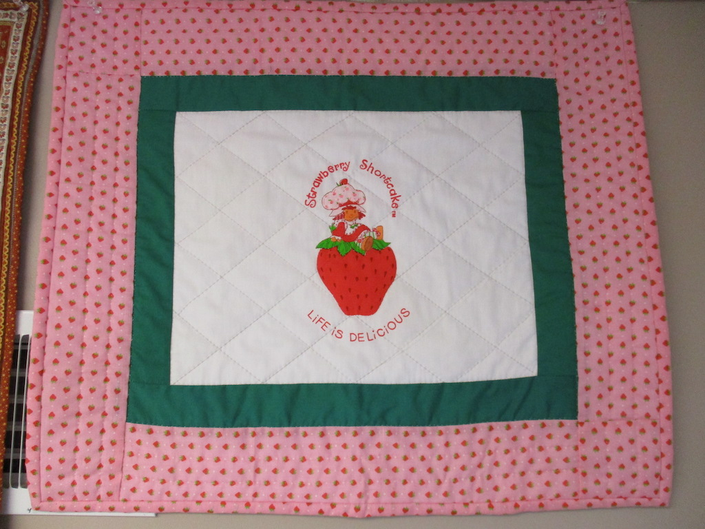 45, STRAWBERRY SHORTCAKE PREPRINT (signed and dated), 19x22, Pieced by Nancy Cordell, Quilted by Marie Eby