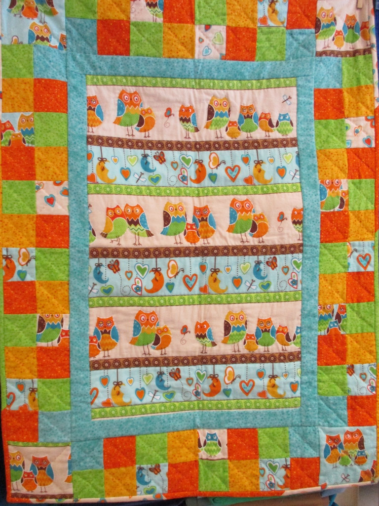 48, OWLS FLANNEL PREPRINT WITH PIECED BORDER (signed and dated), 30x40, Pieced and Quilted by Norma Huss