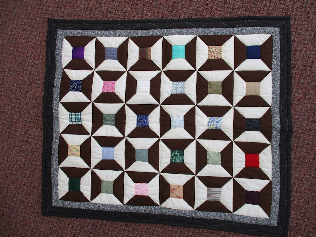 62, SPOOLS, 32x38, Pieced, Quilted and Donated by Anna Lauver
