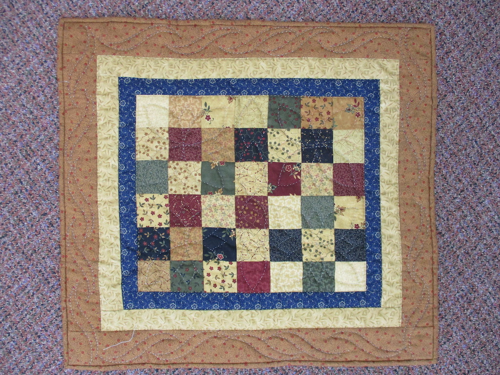 80, SNAPPY SQUARES (signed and dated), 21x23, Pieced, Quilted and Donated by Kathy Mast