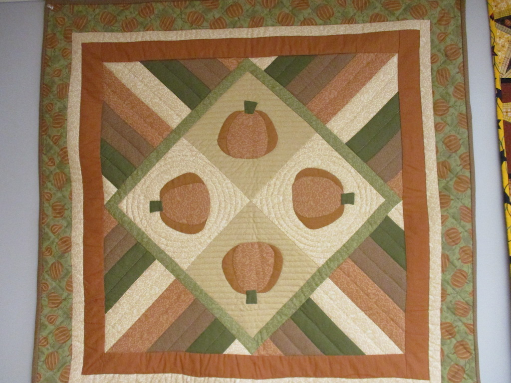 86, PUMPKIN PATCH TABLE TOPPER (signed and dated), 39x40, Pieced by Dorothy Crider, Quilted by Janet Crider