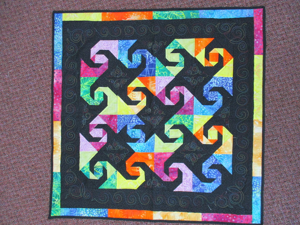 93, SNAILS' TRAIL (machine quilted), 34x34, Pieced and Donated by Linda Matthews
