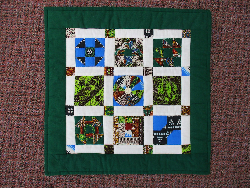 119, AFRICAN SAMPLER (signed and dated), 17x17, Pieced, Quilted and Donated by Janet Runion Patton