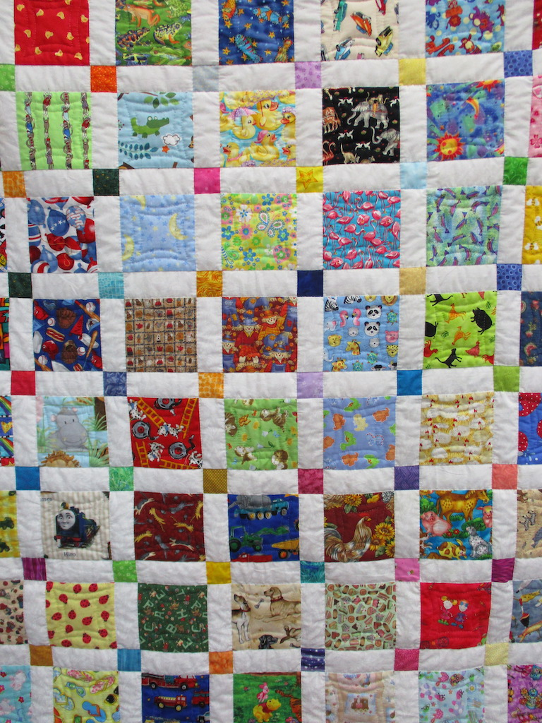 121, I SPY, 50x56, Pieced and Donated by Barb Garrett, Quilted by MCC Volunteers
