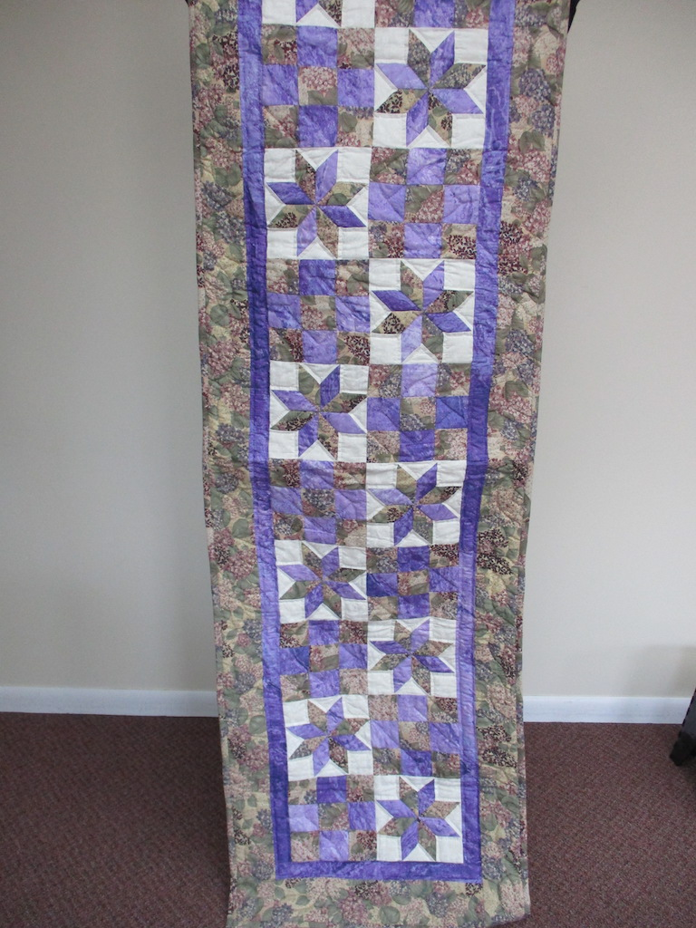 122, STAR LOG CABIN (signed and dated), 25x82, Quilted and Donated by Esther Martin